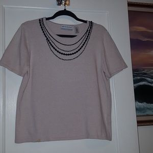 Beautiful tan sweater with black necklace